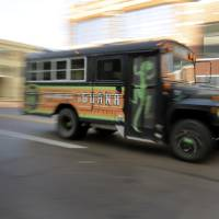 Photo -  The Iguana Mexican Grill shuttle bus carries fans April 21 before Game 2 of the Thunder's playoff series with Memphis. Photo by Doug Hoke, The Oklahoman   DOUG HOKE -