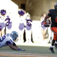 Photo -  Oklahoma State's Daytawion Lowe (8) is headed to the East-West  Shrine game. Photo by Sarah Phipps, The Oklahoman