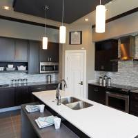 Photo - The kitchen of the model home has plenty of space for food preparation, eating and entertaining.