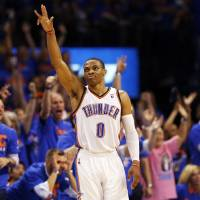 Photo -  Oklahoma City's Russell Westbrook (0) reacts after hitting a 3-point shot in the fourth quarter during Game 7 in the first round of the NBA playoffs between the Oklahoma City Thunder and the Memphis Grizzlies at Chesapeake Energy Arena in Oklahoma City, Saturday, May 3, 2014. The Thunder won 120-109. Photo by Nate Billings, The Oklahoman