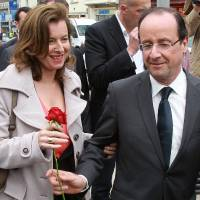 Photo - FILE - In this May 5, 2012 file photo, French Socialist Party candidate for the presidential election Francois Hollande, right, offers a rose to his companion Valerie Trierweiler, in Tulle, southwestern France. The woman considered France's first lady was hospitalized after a report the president is having an affair with an actress, her office said Sunday, as a poll was released showing the French shrugging off any liaison as none of their business. (AP Photo/Bob Edme, File)