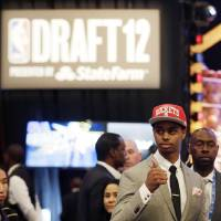 Photo - Connecticut's Jeremy Lamb gestures moments after being selected No. 12 by the Houston Rockets during the NBA basketball draft, Thursday, June 28, 2012, in Newark, N.J. (AP Photo/Julio Cortez) ORG XMIT: NJJC120