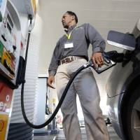 Photo - FILE - In this Friday March 7, 2014 file photo, Eric Henry puts gasoline in his car in Sacramento, Calif. Despite a bipartisan push, the Senate's Democratic leaders have so far derailed efforts to halt an increase in the price  of gasoline and other fuels that will hit consumers in January 2015. (AP Photo/Rich Pedroncelli, File)