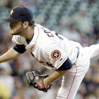 Photo - Houston Astros' Jarred Cosart follows through on a pitch against the Atlanta Braves in the third inning of a baseball game Thursday, June 26, 2014, in Houston. (AP Photo/Pat Sullivan)