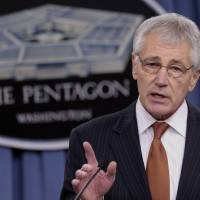 Photo - Defense Secretary Chuck Hagel announces some personal changes, Friday, Feb. 7, 2014, during a briefing at the Pentagon. (AP Photo/Susan Walsh)