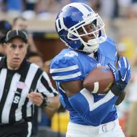 Photo - Duke's Jamison Crowder catches a pass for a 46-yard touchdown from quarterback Anthony Boone in the first half against Elon during an NCAA college football game Saturday, Aug. 30, 2014, in Durham, N.C. (AP Photo/The Herald-Sun, Bernard Thomas)