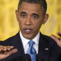 Photo - President Barack Obama gestures as he speaks during the last news conference of his first term in the East Room of the White House in Washington, Monday, Jan. 14, 2013. (AP Photo/Carolyn Kaster)