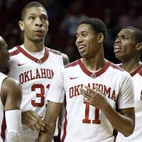 Photo -  Oklahoma Sooner's Jordan Woodard (10), D.J. Bennett (31), Isaiah Cousins (11) and Buddy Hield (24) react to play as the University of Oklahoma Sooners (OU) men defeat the Iowa State Cyclones (ISU) 87-82 in NCAA, college basketball at The Lloyd Noble Center on Saturday, Jan. 11, 2014  in Norman, Okla. Photo by Steve Sisney, The Oklahoman