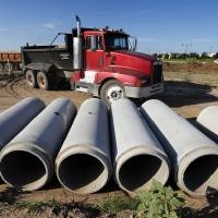Photo - Pipes lie ready for installing at Legacy Park, a large public park under construction on 24th Avenue NW, north of Robinson Street in Norman. PHOTO BY STEVE SISNEY, THE OKLAHOMAN  STEVE SISNEY