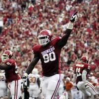 Photo -   Oklahoma defensive end David King celebrates after Oklahoma recovered a fumble against Texas during the first half of an NCAA college football game at the Cotton Bowl Saturday, Oct. 13, 2012, in Dallas. (AP Photo/The Daily Texan, Lawrence Peart)