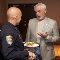 Photo -  Edmond Deputy Chief of Police Tim Dorsey speaks to Edmond Mayor Charles Lamb before the Edmond Chamber of Commerce luncheon. PHOTO BY PAUL HELLSTERN, THE OKLAHOMAN   PAUL HELLSTERN -