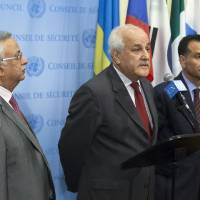 Photo - Palestinian U.N. Ambassador Riyad Mansour, center, speaks following a meeting of the U.N. Security Council on the situation in Gaza at United Nations headquarters, Monday, July 28, 2014. The U.N. Security Council called for
