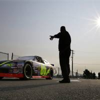 Photo - A race car heads out to the track during an early morning practice session for a NASCAR K&N Pro Series auto race at Watkins Glen International, Friday, Aug. 8, 2014, in Watkins Glen N.Y. (AP Photo/Mel Evans)