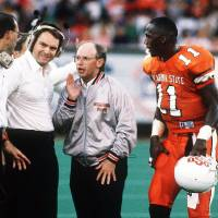 Photo - OKLAHOMA STATE UNIVERSITY / COWBOYS FOOTBALL: OSU player Hart Lee Dykes listens to coaches Pat Jones, right, Houston Nutt, middle, and unidentified.
