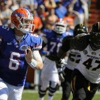Photo -   Florida quarterback Jeff Driskel (6) scrambles with the ball as Missouri defensive lineman Kony Ealy (47) tries to stop him during the first half of an NCAA college football game, Saturday, Nov. 3, 2012, in Gainesville, Fla. (AP Photo/Phil Sandlin)