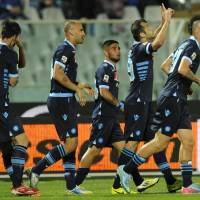Photo - Napoli Macedonian forward Goran Pandev, second right, celebrates after scoring during a Serie A soccer match between Pescara and Napoli, at the Adriatico stadium in Pescara, Italy, Saturday, April 27, 2013. (AP Photo/Sandro Perozzi)