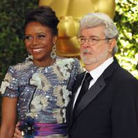 "Photo - FILE - In this Nov. 16, 2013 file photo, filmmaker George Lucas and his wife, Chicago native Mellody Hobson, are seen on the red carpet at the 2013 Governors Awards in Los Angeles. Chicago Mayor Rahm Emanuel is trying to persuade the ""Star Wars"" creator to put his planned museum of art and movie memorabilia in Chicago and is offering up a slice of real estate along the Lake Michigan shorefront where it would be located. A competing bid from San Francisco seems a more natural fit: it's Lucas' hometown, it's a premier center of technology and innovation and it's closer to the nation's movie-making heartland. (Photo by John Shearer/Invision/AP)"