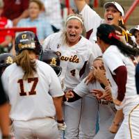 Photo -  Arizona State celebrates after a home run by Katelyn Boyd (17) in the fifth inning during a Women's College World Series softball game between the University of Oklahoma and Arizona State University at ASA Hall of Fame Stadium in Oklahoma City, Thursday, June 2, 2011. ASU won, 3-1. Photo by Nate Billings, The Oklahoman