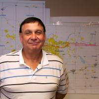 Photo - Larry J. Bledsoe, Apache Corp.'s district production manager for Elk City, oversees the more than 1,100 Apache wells in the Elk City area. He said the company has identified more than 10,000 potential drill sites in the area.