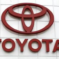 Photo - FILE - In this March 30, 2011 file photo, the Toyota logo is shown at Wilsonville Toyota, in Wilsonville, Ore. (AP Photo/Rick Bowmer)