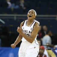 Photo - Texas A&M center Rachel Mitchell (23) reacts after scoring in the first half against Auburn during an NCAA college basketball game in the quarterfinals of the Southeastern Conference women's tournament, Friday, March 7, 2014, in Duluth, Ga. (AP Photo/Jason Getz)