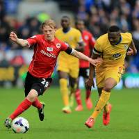 Photo - Crystal Palace's Kagisho Dikgacoi, right, and Cardiff City's Mats Daehli battle for the ball during their English Premier League soccer match at Cardiff City Stadium, Cardiff, Saturday April 5, 2014. (AP Photo/PA, Nick Potts) UNITED KINGDOM OUT  NO SALES  NO ARCHIVE