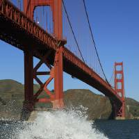 Photo - A wave breaks under the Golden Gate Bridge at high tide Thursday, Dec. 13, 2012 in San Francisco. The National Weather Service says so-called King Tides — caused by a rather unique combination of how the sun, the moon and the earth align — will bring the highest tides of the year on Thursday, Friday and Saturday mornings. Along with the high tides, forecasters say a building swell will bring large breaking waves to area beaches. The San Francisco Chronicle reports the combination of high tides and surf has flooded some parking lots in San Francisco and in Marin County. (AP Photo/Ben Margot)