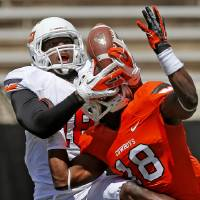 Photo - Oklahoma State's Blake Jackson, left, catches the ball but is unable to hold on beside Deion Imade during OSU's spring football game at Boone Pickens Stadium in Stillwater, Okla., Sat., April 20, 2013. Photo by Bryan Terry, The Oklahoman