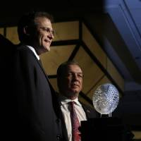 Photo - Auburn head coach Gus Malzahn, left, and Florida State head coach Jimbo Fisher pose with The Coaches' Trophy during a news conference for the NCAA BCS National Championship college football game Sunday, Jan. 5, 2014, in Newport Beach, Calif. Florida State plays Auburn on Monday, Jan. 6, 2014. (AP Photo/Morry Gash)