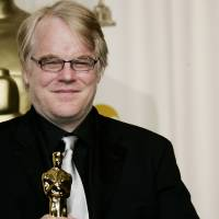 Photo - FILE - In a Sunday, March 5, 2006, file photo, actor Philip Seymour Hoffman poses with the Oscar he won for best actor for his work in