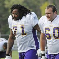 Photo - Minnesota Vikings rookie tackle Phil Loadholt (71) and Drew Radovich move to another field during NFL football training camp, Saturday, Aug. 1, 2009, in Mankato, Minn. (AP Photo/Jim Mone) ORG XMIT: MNJM101