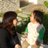 "Photo - In this photo released by Minako Kubota, Kubota chats with her two-year-old son in Naha, Okinawa, Japan. Okinawa is about as far away as one can get from Fukushima without leaving Japan, and that is why Kubota is here. Petrified of the radiation spewing from the Fukushima Dai-ichi nuclear plant that went into multiple meltdowns last year, Kubota grabbed her children, left her skeptical husband and moved to the small southwestern island. More than a thousand people from the disaster zone have done the same thing. ""I thought I would lose my mind,"" Kubota told The Associated Press in a recent interview. ""I felt I would have no answer for my children if, after they grew up, they ever asked me,"