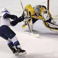 Photo - Nashville Predators goalie Pekka Rinne (35), of Finland, gloves a penalty shot attempt by St. Louis Blues left wing Alexander Steen (20) in the second period of an NHL hockey game Thursday, March 6, 2014, in Nashville, Tenn. (AP Photo/Mark Humphrey)
