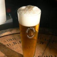 Photo - In this undated photo a glass of Dock Street Ale is seen in an unknown location. (AP Photo/Dock Street Brewery)