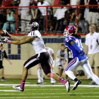 Photo -   Texas A&M's Mike Evans, left, catches a 75-yard touchdown pass against Louisiana Tech during an NCAA college football game in Shreveport, La., Saturday, Oct. 13, 2012. (AP Photo/Kita K Wright)