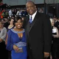 Photo - FILE - In this Feb. 26, 2012 file photo, Sherri Shepherd and  Lamar Sally arrive before the 84th Academy Awards in the Hollywood section of Los Angeles. Court records show Sally filed for legal separation from Shepherd in Los Angeles on May 2, 2014, citing irreconcilable differences and custody of the pair's unborn child. (AP Photo/Matt Sayles, file)