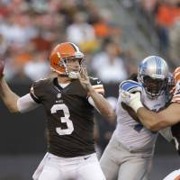 Photo - FILE - In this Aug. 15, 2013 file photo, Cleveland Browns quarterback Brandon Weeden passes in a preseason NFL football game against the Detroit Lions the Detroit Lions in Cleveland. Weeden was named Cleveland's starting quarterback on Tuesday, Aug. 20, 2013, ending a