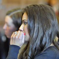 Photo - Alexis Wright appears with her attorney, Sarah Churchill, Friday, March 29, 2013 in Cumberland County Court, in Portland, Maine. Wright, a dance instructor accused of using her Zumba fitness studio as a front for prostitution pleaded guilty Friday to 20 counts in a scandal that captivated a quiet seaside town. (AP Photo/Portland Press Herald, John Ewing, Pool)