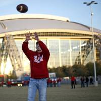 Photo - Chase McDonald of Beaumont, Texas, catches football before the Big 12 football championship game between the University of Oklahoma Sooners (OU) and the University of Nebraska Cornhuskers (NU) at Cowboys Stadium on Saturday, Dec. 4, 2010, in Arlington, Texas.  Photo by Bryan Terry, The Oklahoman