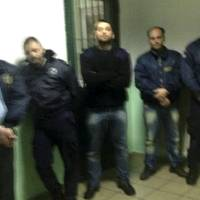 Photo - This photo taken by an unnamed prisoner with a cellphone shows hostages, both prison officers and prisoners, being held by Albanian convict Alket Rizaj  at Malandrino prison, in central Greece, on Saturday, March 16, 2013. Rizaj is demanding to be allowed to leave the prison, claiming to be heavily armed.  Police special forces have deployed outside the prison, while prison officers, Rizaj's lawyer, and a prosecutor try to negotiate with him. (AP Photo)