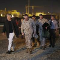 Photo - Defense Secretary Chuck Hagel walks with U.S. Marine General Joseph Dunford, commander of the International Security Force, upon Hagel's arrival near Camp Eggers in Kabul, Afghanistan, Friday, March 8, 2013. Hagel arrived in Afghanistan Friday for his first visit as Pentagon chief, saying that there are plenty of challenges ahead as NATO hands over the country's security to the Afghans. (AP Photo/Jason Reed, Pool)