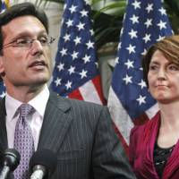 Photo - FILE - In this May 3, 2011 file photo, House Majority Leader Eric Cantor of Va., accompanied by Rep. Cathy McMorris Rodgers, R-Wash., speaks to reporters on Capitol Hill in Washington. House Republican leaders took a small step on Friday toward pulling together a viable alternative to President Barack Obama's four-year-old health care law. On Friday, Cantor met privately with Rodgers, the vice chairman of the Republican Conference and three Republican committee chairmen _ Budget's Paul Ryan of Wisconsin, Education's John Kline, of Minnesota, and Ways and Means' Dave Camp of Michigan to discuss a way forward. (AP Photo/Jacquelyn Martin, File)