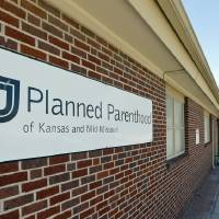 Photo - This photo shows the Planned Parenthood at 2226 E Central Ave. in Wichita, Kan. A federal appeals court on Tuesday, March 25, 2014, ruled that Kansas can strip two Planned Parenthood clinics of federal family planning money while the organization moves forward with its legal challenge of a state law it says is retaliation for its advocacy of abortion rights. (AP Photo/The Wichita Eagle, Mike Hutmacher)