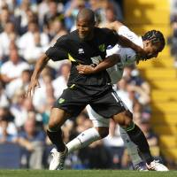 Photo -   Tottenham Hotspur's Benoit Assou-Ekotto, right, competes with Norwich City's Simeon Jackson during their English Premier League soccer match at White Hart Lane, London, Saturday, Sept. 1, 2012. (AP Photo/Sang Tan)