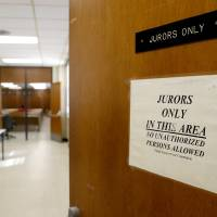 Photo - A sign posted on the door to the jury assembly room in the Oklahoma County courhouse.  Bryan Terry - THE OKLAHOMAN