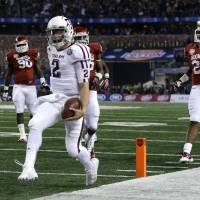 Photo - Texas A&M's Johnny Manziel (2) reaches the end zone for a touchdown as Oklahoma's Frank Shannon (20) and others give chase in the first half of the Cotton Bowl NCAA college football game Friday, Jan. 4, 2013, in Arlington, Texas. (AP Photo/LM Otero)