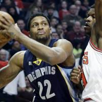 Photo - Memphis Grizzlies forward Rudy Gay, left, looks to the basket as Chicago Bulls guard Jimmy Butler guards during the first half of an NBA basketball game in Chicago on Saturday, Jan. 19, 2013. (AP Photo/Nam Y. Huh) ORG XMIT: CXA103