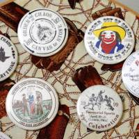 Photo -       These are part of an 89er Day button collection. Photo By Paul Hellstern, The Oklahoman Archive    PAUL HELLSTERN