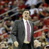 Photo - Houston Rockets coach Kevin McHale questions a foul call during the first quarter of Game 4 in their first-round NBA basketball playoff series against the Oklahoma City Thunder Monday, April 29, 2013, in Houston. (AP Photo/David J. Phillip)