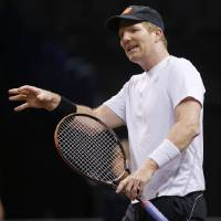 Photo - Jim Courier talks during a Champions Cup tennis match against Michael Chang at Chesapeake Energy Arena in Oklahoma City, Thursday, Feb. 6, 2014. Photo by Bryan Terry, The Oklahoman